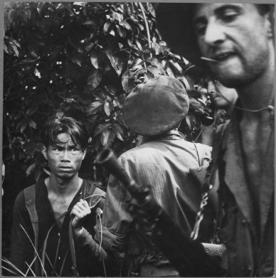 the_french_foreign_legion_is_playing_the_major_combat_role_in_the_war_against_the_vietminh-_here_a_red-suspect_has_been_-_nara_-_541969-tif